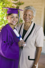 Graduate and grandmother outside, portrait