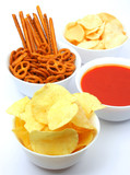 Chips, salty sticks and pretzels with salsa dip sauce poster
