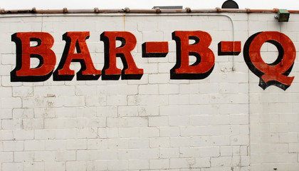 Bar-B-Q sign on the side of a building
