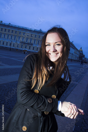 Girl posing in evening city