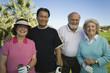 Group senior golfers on golf course, portrait