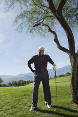 Senior man on golf course, portrait
