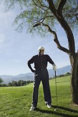 Senior man on golf course, portrait