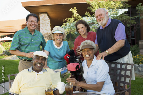 Group of senior golfers celebrating success, relaxing, portrait