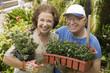 Senior couple gardening, portrait