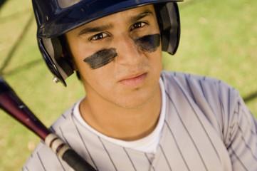 Baseball player with eye black, holding baseball bat on shoulder, portrait, elevated view
