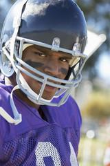Football Player wearing helmet on field, portrait, portrait