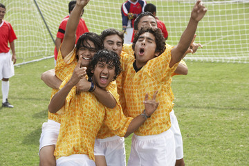 Cheering soccer team, portrait