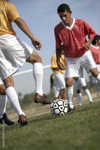 Soccer players competing for ball