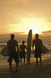 Surfers Enjoying Sunset