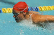 Woman swimming butterfly stroke, close-up