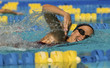 Woman swimming in pool, close-up