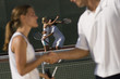 Tennis Players Shaking Hands at Net, side view