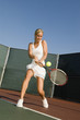 Tennis Player Hitting Backhand on tennis court