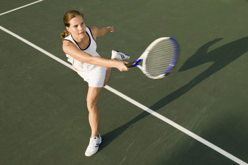 Tennis Player swinging racket in Forehand motion