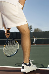 Tennis Player holding tennis racket, Waiting For Serve, low section, back view
