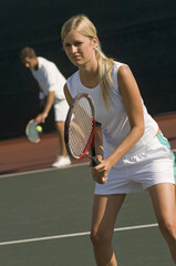 Tennis Player holding racket, Waiting For doubles partner to Serve