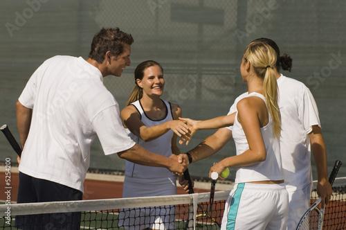 Tennis Players Shaking Hands at Net after tennis match