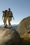 Couple Hiking on Boulders