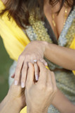 Placing Wedding Ring on Woman's Finger, mid section, close-up