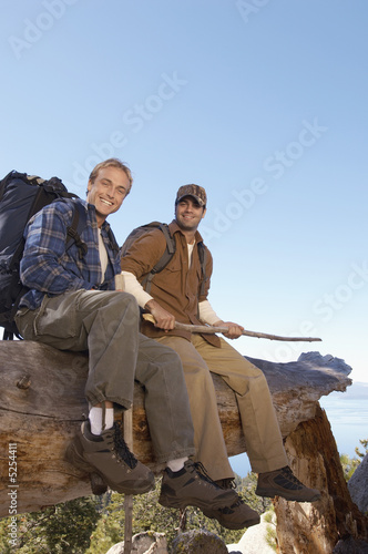 Hikers Sitting on a Log