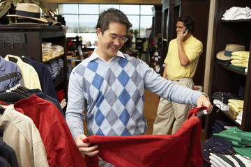 Mid-adult man looking at merchandise, shopping in Golf Shop