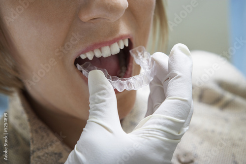 Woman having dental mold fitted, close-up
