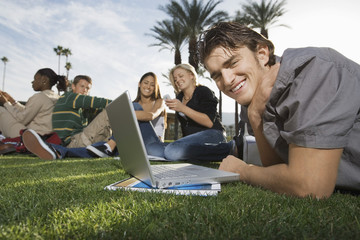College students on campus studying outdoors