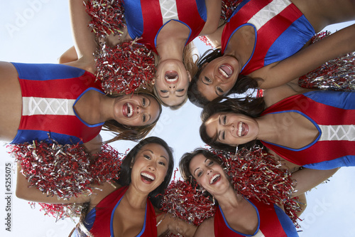 Cheerleaders in a Huddle from below