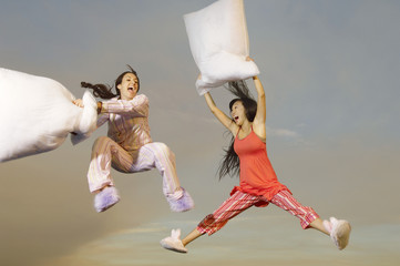 Women Having Pillow Fight