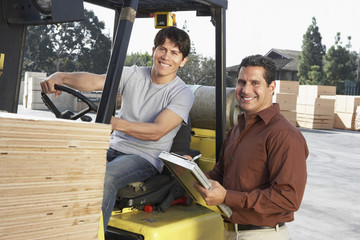 Manager with Forklift Driver at  Warehouse
