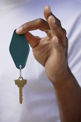 Man holding key in hand, close up on hand