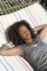 Woman lying, sleeping in hammock, half length