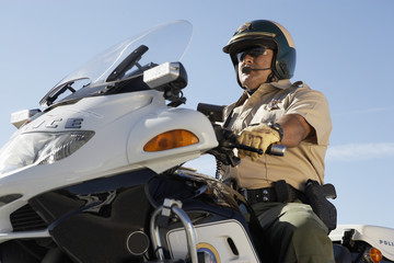Police officer riding on motorcycle