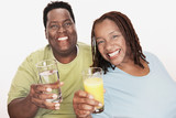 Overweight Couple holding healthy beverage, smiling, portrait
