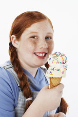 Overweight girl 13-15 smiling, holding ice cream cone, portrait