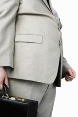 Overweight Man carrying briefcase, mid section, side view
