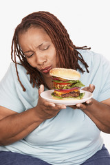 Overweight Woman holding hamburger