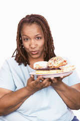 Overweight Woman holding Junk Food, portrait