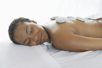Woman Receiving hot stone therapy