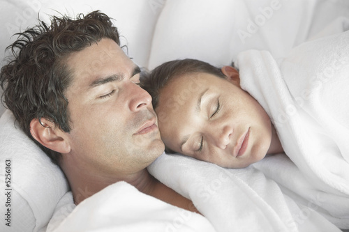 Couple snoozing at spa, head and shoulders