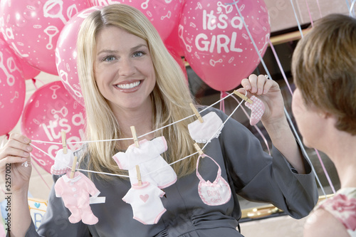 Woman holding up gift at baby shower