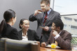 Businesspeople in eating and drinking in board room