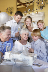 Grandmother smiling at party with whole family