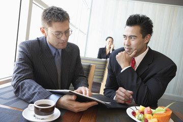 Two Businessmen in Lunch Meeting in Restaurant