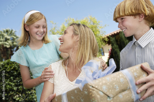 Mothering Opening a Gift from her Children