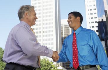Businessmen shaking hands, outdoors