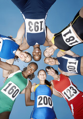 Track and Field Athletes in Huddle