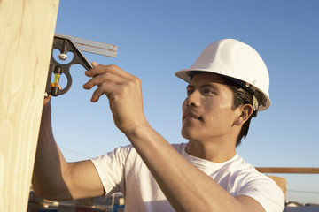 Construction Worker in Hard Hat Building House