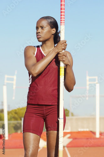 Female athlete with pole vault